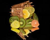Φρούτα με τα candys Στοκ Εικόνες