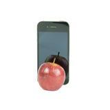 Φρούτα της Apple και έξυπνο τηλέφωνο που απομονώνονται στο λευκό Στοκ Φωτογραφία