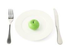 Φρούτα της Apple σε ένα πιάτο που απομονώνεται Στοκ Φωτογραφία
