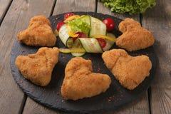 Φτερά κοτόπουλου που τηγανίζονται στις τριμμένες φρυγανιές χρυσές Στοκ εικόνα με δικαίωμα ελεύθερης χρήσης