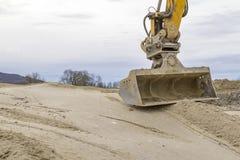 Φτυάρι και εργοτάξιο οικοδομής εκσκαφέων Στοκ εικόνα με δικαίωμα ελεύθερης χρήσης