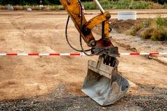Φτυάρι Excavaor στις οδικές εργασίες στοκ φωτογραφίες