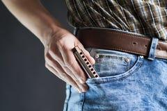 Φυσαρμόνικα μπλε στην τσέπη Στοκ φωτογραφία με δικαίωμα ελεύθερης χρήσης