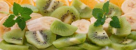 Φυσικό υπόβαθρο από τα κομμάτια των φρούτων Στοκ Φωτογραφίες