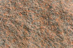 Φυσικό υπόβαθρο σύστασης γρανίτη πετρών κόκκινο Φωτεινή σκληρή κόκκινη σύσταση γρανίτη Κόκκινο υπόβαθρο πετρών σύστασης γρανίτη Στοκ Εικόνες