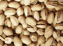 Φυστίκια στα κοχύλια καρυδιών ως υπόβαθρο τροφίμων Στοκ Φωτογραφίες