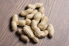 Φυστίκια, υπόβαθρο φυστικιών Σπόρος φυστικιών Σύσταση φυστικιών σύντομων χρονογραφημάτων Καφετί φυστίκι Υλικό φυστικιών Στοκ φωτογραφία με δικαίωμα ελεύθερης χρήσης