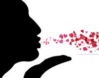 φυσώντας φιλιά στοκ φωτογραφία