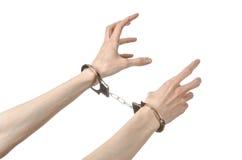 Φυλακή και καταδικασμένο θέμα: χέρια ατόμων με τις χειροπέδες που απομονώνονται επάνω Στοκ Φωτογραφίες