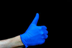 φυλλομετρεί επάνω Η άποψη σχεδιαγράμματος παραδίδει το μπλε ιατρικό γάντι Στοκ φωτογραφία με δικαίωμα ελεύθερης χρήσης