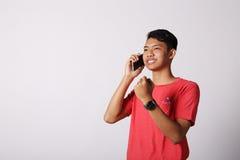 Φυλλομετρεί επάνω το ασιατικό αγόρι Στοκ φωτογραφίες με δικαίωμα ελεύθερης χρήσης