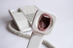 φωνάζοντας τηλέφωνο δεκτ Στοκ Φωτογραφίες