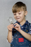 φως βολβών αγοριών Στοκ εικόνες με δικαίωμα ελεύθερης χρήσης