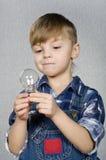 φως βολβών αγοριών Στοκ φωτογραφία με δικαίωμα ελεύθερης χρήσης