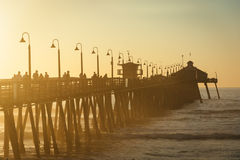 Φως ηλιοβασιλέματος στην αποβάθρα αλιείας στην αυτοκρατορική παραλία, Καλιφόρνια Στοκ Εικόνες