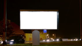 Φως πόλεων και χλεύη αφισών πινάκων διαφημίσεων επάνω στη δέσμη απόθεμα βίντεο