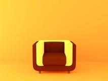 Φωτεινή καρέκλα σε ένα φωτεινό πορτοκαλί υπόβαθρο Στοκ φωτογραφία με δικαίωμα ελεύθερης χρήσης