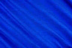 Φωτεινή μπλε σύσταση υφάσματος με τις πτυχές στοκ εικόνα