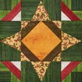 Φωτεινός πορτοκαλής-πράσινος γεωμετρικός φραγμός προσθηκών από τα κομμάτια των υφασμάτων, λεπτομέρεια του παπλώματος Στοκ φωτογραφία με δικαίωμα ελεύθερης χρήσης