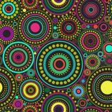Φωτεινό άνευ ραφής αφηρημένο σχέδιο των ζωηρόχρωμων κύκλων και των σημείων στο μαύρο υπόβαθρο Σκηνικό καλειδοσκόπιων Στοκ εικόνα με δικαίωμα ελεύθερης χρήσης