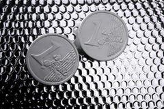 φωτεινό ευρώ νομισμάτων πέρ&alph Στοκ Φωτογραφίες