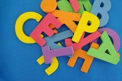 Φωτεινό διαφορετικό χρώμα ενός γράμματος της αλφαβήτου Στοκ Εικόνες