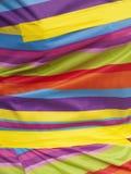 Φωτεινό πολύχρωμο ύφασμα Στοκ φωτογραφίες με δικαίωμα ελεύθερης χρήσης
