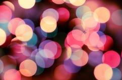 Φωτεινό υπόβαθρο Παραμονής Χριστουγέννων Η αφθονία του χρυσού σπινθηρίσματος bokeh από τα φω'τα γιρλαντών στοκ φωτογραφία με δικαίωμα ελεύθερης χρήσης