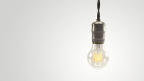 Φωτισμένος τρισδιάστατος τρύγος lightbulb πέρα από ένα φωτεινό άσπρο υπόβαθρο Στοκ Εικόνες
