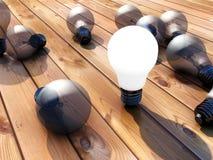 Φωτισμένος lightbulb και παρκέ Στοκ Εικόνες