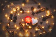 Φωτισμοί διακοπών και παιχνίδια μορφής καρδιών στοκ εικόνα