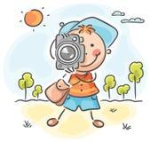 Φωτογράφος με μια κάψουλα, μια τσάντα και μια κάμερα ελεύθερη απεικόνιση δικαιώματος