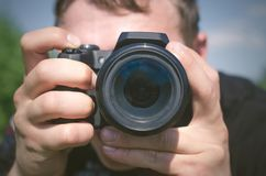 Φωτογράφος camera isolated man over photo white στοκ εικόνα
