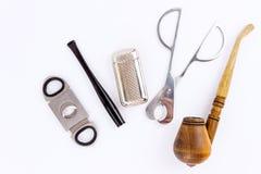 Φωτογραφία αντικειμένου ενός σωλήνα, ένας αναπτήρας, ένας κάτοχος τσιγάρων και Στοκ Εικόνες
