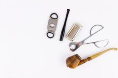 Φωτογραφία αντικειμένου ενός σωλήνα, ένας αναπτήρας, ένας κάτοχος τσιγάρων και Στοκ Εικόνα