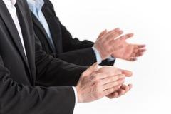 Φωτογραφία των χεριών επιχειρηματιών που επιδοκιμάζουν στο άσπρο υπόβαθρο Στοκ φωτογραφία με δικαίωμα ελεύθερης χρήσης