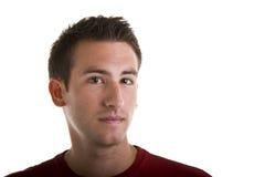 φωτογραφική μηχανή που φαίνεται συμπαθητικές κόκκινες νεολαίες πουκάμισων ατόμων Στοκ εικόνα με δικαίωμα ελεύθερης χρήσης