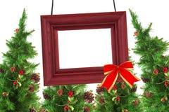Φωτογραφικό πλαίσιο και χριστουγεννιάτικα δέντρα Στοκ φωτογραφία με δικαίωμα ελεύθερης χρήσης