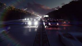 Φω'τα αυτοκινήτων νύχτας και βαριά κυκλοφορία Τα αυτοκίνητα με τους προβολείς συνεχίζονται στην πόλη τη νύχτα φιλμ μικρού μήκους