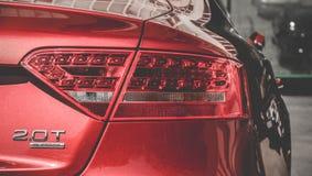 Φω'τα μπροστινός-άποψης Audi, προβολείς κινηματογραφήσεων σε πρώτο πλάνο του πίσω προφυλακτήρα αυτοκινήτων Στοκ εικόνα με δικαίωμα ελεύθερης χρήσης
