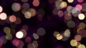Φω'τα σπινθηρίσματος σε ένα σκοτεινό υπόβαθρο απόθεμα βίντεο