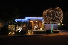 Φω'τα σπιτιών Χαρούμενα Χριστούγεννας στοκ εικόνα