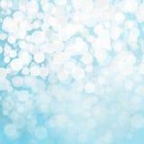 Φω'τα χιονιού Defocused στο μπλε υπόβαθρο Στοκ Εικόνες