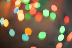Φω'τα Χριστουγέννων bokeh που θολώνονται από το υπόβαθρο εστίασης Στοκ Φωτογραφία