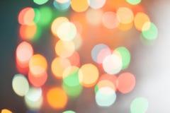 Φω'τα Χριστουγέννων bokeh που θολώνονται από το υπόβαθρο εστίασης Στοκ Φωτογραφίες