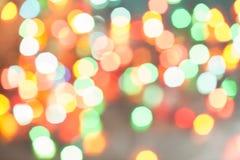 Φω'τα Χριστουγέννων bokeh που θολώνονται από το υπόβαθρο εστίασης Στοκ Εικόνες