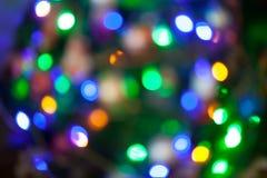 Φω'τα Bokeh χριστουγεννιάτικων δέντρων που θολώνεται από το υπόβαθρο εστίασης Στοκ Φωτογραφίες