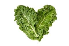 Φύλλα του Kale που διαμορφώνουν μια καρδιά στοκ εικόνες