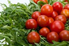 Φύλλα Ruccola και ντομάτες κερασιών Στοκ εικόνα με δικαίωμα ελεύθερης χρήσης