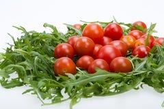 Φύλλα Ruccola και ντομάτες κερασιών Στοκ φωτογραφίες με δικαίωμα ελεύθερης χρήσης